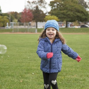 Photo of girl chasing bubbles